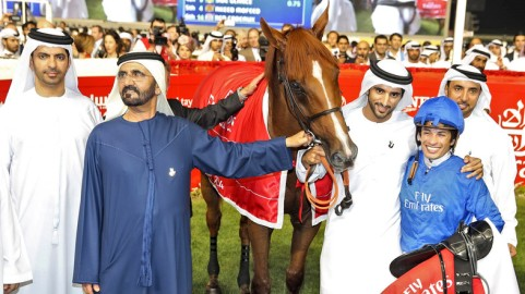 United Arab Emirates' Prime Minister and Ruler of Dubai Rashid al-Maktoum poses with his horse African Story after winning the Dubai World Cup at Meydan Racecourse in Dubai March 29, 2014.